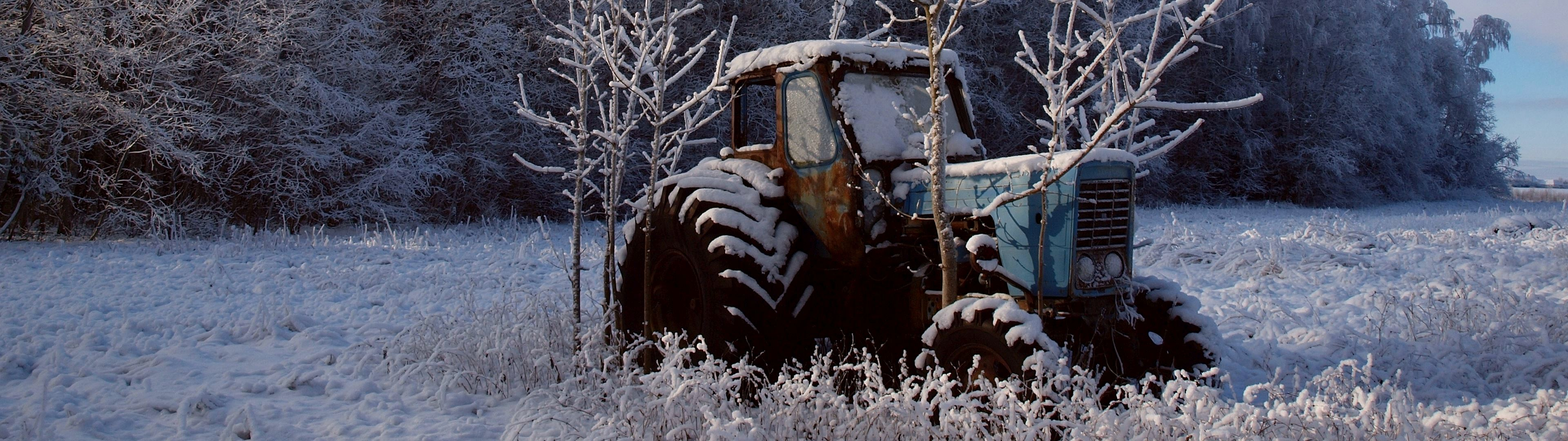 WallpaperFusion-old-tractor-in-the-snow-3840x1080.jpg